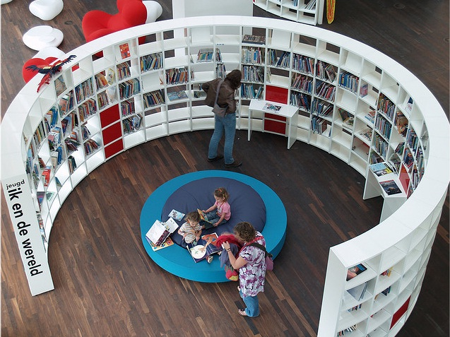 Located in the Openbare Bibliotheek Amsterdam (OBA) in Amsterdam, this curved  bookshelf is attractive and appealing.