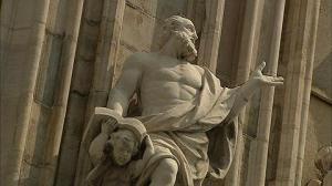 Statue of man reading book, Milan, Italy